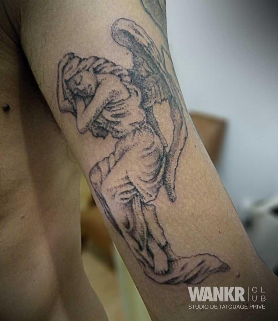 sleeping angel tattoo
